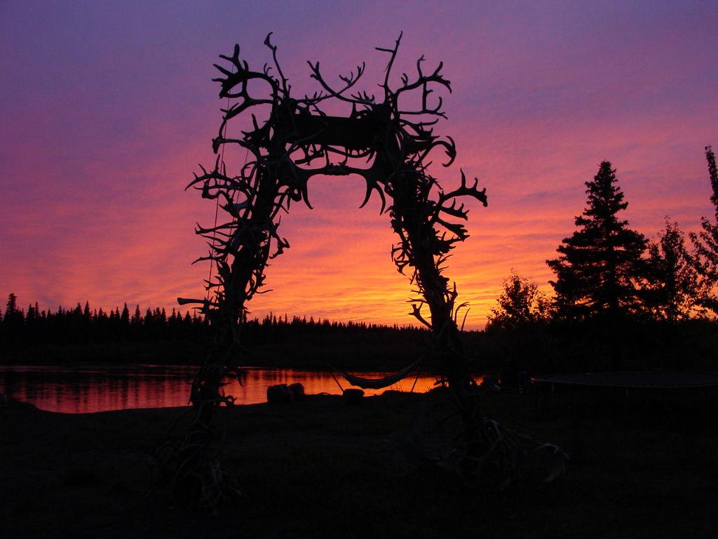 Alaskan subsistence camp at sunset