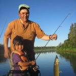 Tom and granddaughter fishing