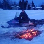 Winter at Alaskan NW Adventures Camp- Snowmobile and Camp Fire