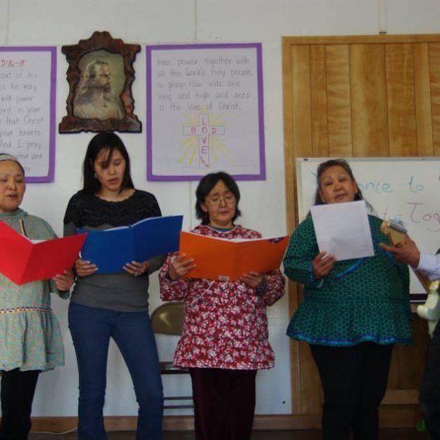 Singing in Church wearing Kuspuks